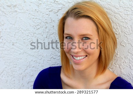 Young Woman Blonde Hair Smiling and Happy College Student - stock photo