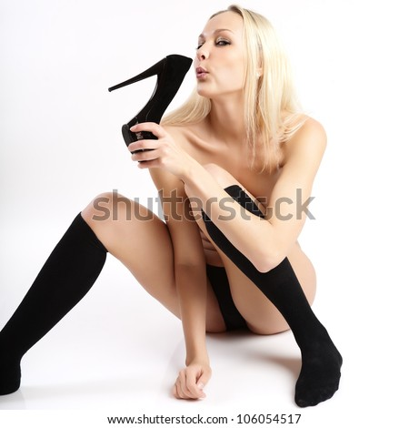 Young woman blowing in the shoes. - stock photo