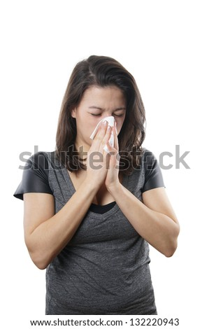 young woman blowing nose with paper tissue - stock photo