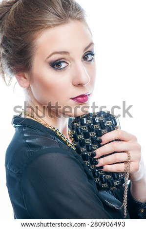 Young woman blowing soap bubbles - stock photo