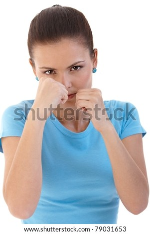 Young woman boxing, defending herself with clenched fists.? - stock photo