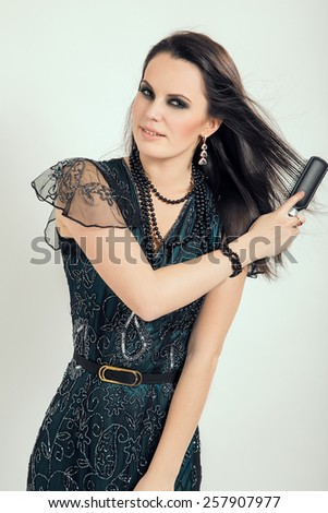 Young woman brushing her hair