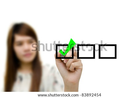 Young woman business hand with pen mark the check boxes. - stock photo