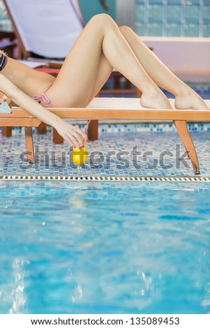 Young woman by the pool - stock photo