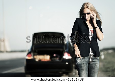 Young woman calling for help. - stock photo