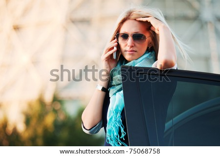 Young woman calling on the mobile phone - stock photo