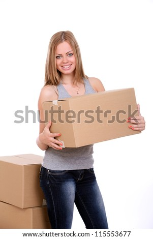 Young woman carrying cardboard box over white background - stock photo