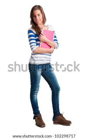 Young woman carrying notebooks in her arms - stock photo