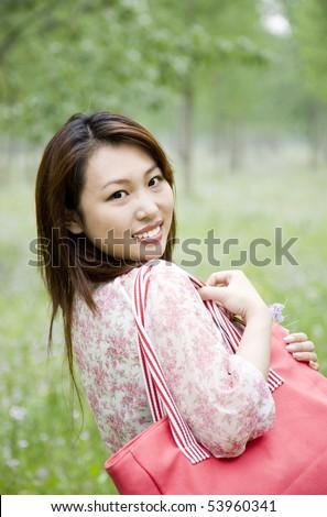 young woman carrying shopping bag - stock photo