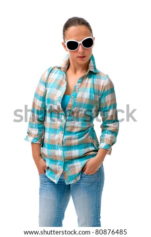 young woman casually dressed on white background with sunglasses - stock photo