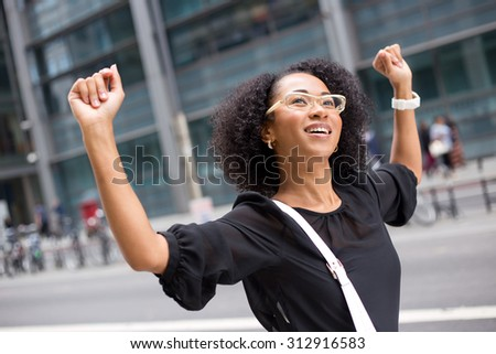 young woman celebrating - stock photo