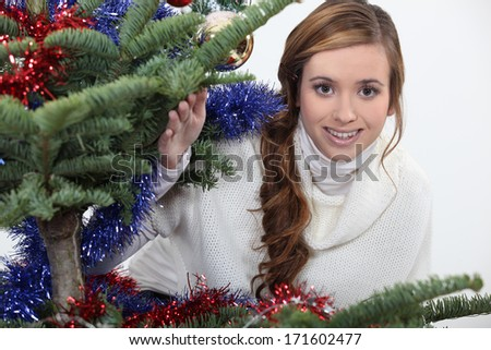 Young woman celebrating Christmas - stock photo