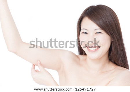 young woman checking her upper arm, isolated on white background - stock photo