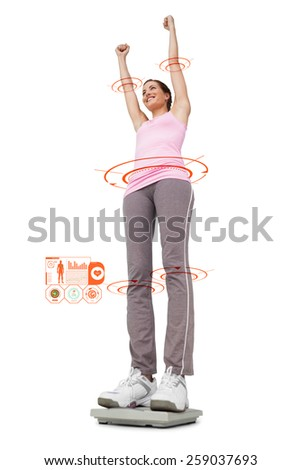 Young woman cheering on weight scale against fitness interface - stock photo