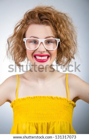 Young woman cheering or smiling, funny girl - stock photo