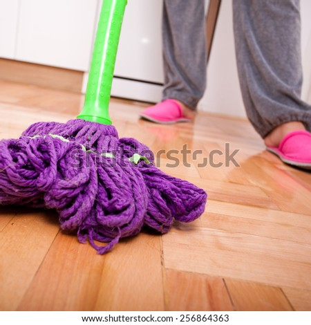 Young woman cleaning and doing housework - stock photo
