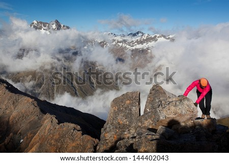 Young woman climbing in the Alps - stock photo
