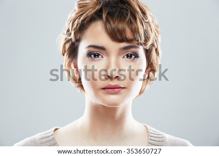 Young woman close up face beauty portrait. Female model isolated white background. - stock photo