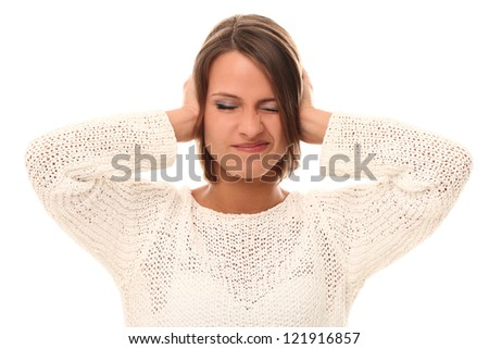 Young woman closing her ears in stress over a white - stock photo