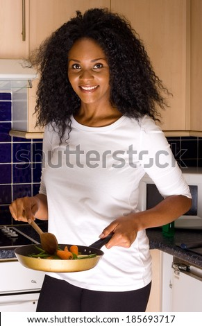 young woman cooking dinner - stock photo