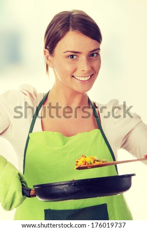 Young woman cooking healthy food - stock photo