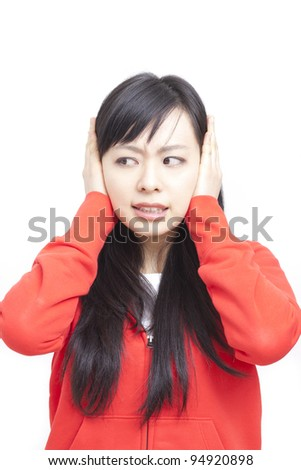young woman covering ears, isolated on white background - stock photo