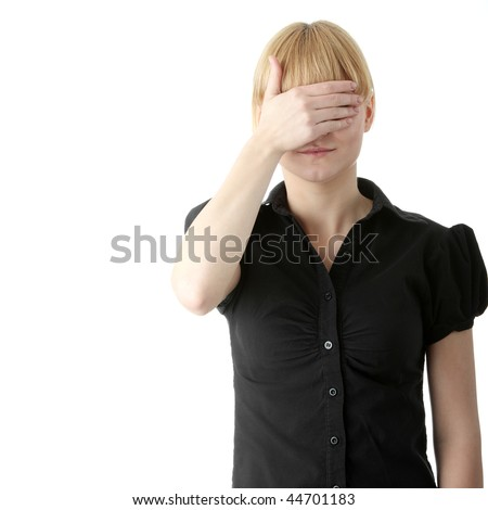 Young woman covering her eyes isolated on white - stock photo