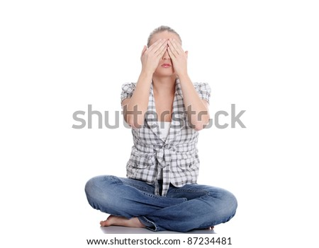 Young woman covering her eyes, isolated on white - stock photo
