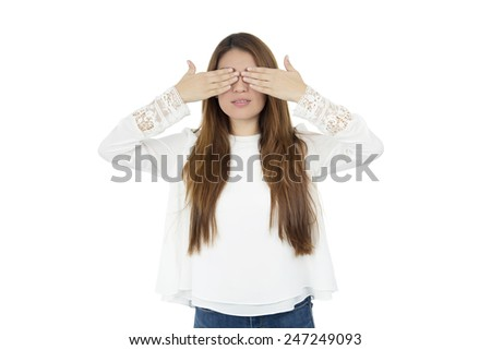 Young woman covering her eyes with her both hands against a white background - stock photo