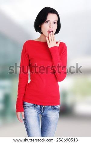 Young woman covering her mouth. - stock photo