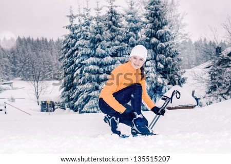 young woman cross-country skiing in a forest - stock photo