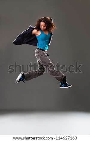 Young woman dancer jumping. - stock photo
