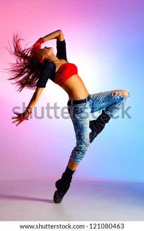 Young woman dancer. On blue and pink background. - stock photo