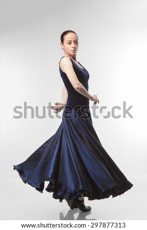 young woman dancing flamenco in blue dress isolated on white background - stock photo