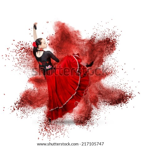 young woman dancing flamenco with castanets against explosion isolated on white - stock photo