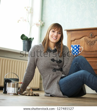 Young woman decorating and relaxing at home - stock photo