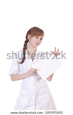 Young woman doctor is holding blank paper - stock photo