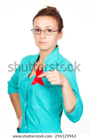 Young woman doctor is showing holding red breast cancer awareness ribbon, isolated over white - stock photo