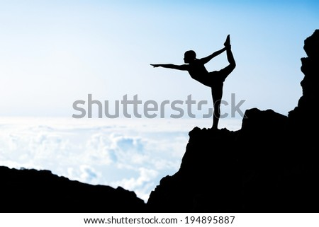 Young woman doing beautiful yoga pose king of the dancer, sunset silhouette in mountains over blue sky and clouds with sun sunlight background. Healthy lifestyle successful fitness exercise concept. - stock photo