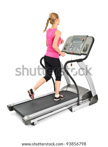 young woman doing exercises on treadmill, on white background, some blurred motion - stock photo