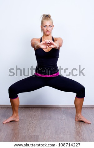 young woman doing fitness exercise - stock photo