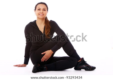 Young woman doing fitness exercises isolated on white background - stock photo