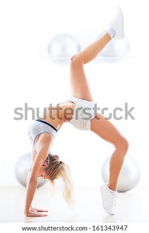 Young woman doing gymnastics - stock photo