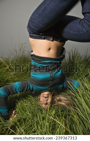 Young Woman Doing Headstand - stock photo