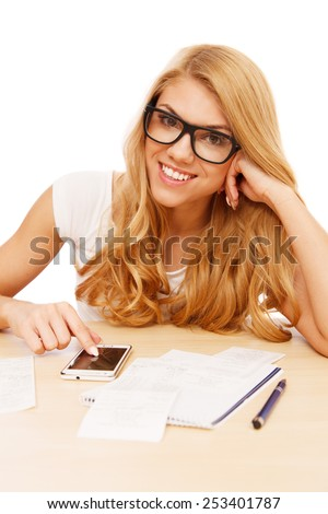 Young woman doing her accounts - stock photo