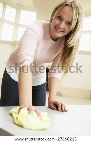 Young Woman Doing Housework - stock photo