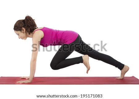 Young woman doing mountain climber during fitness - stock photo
