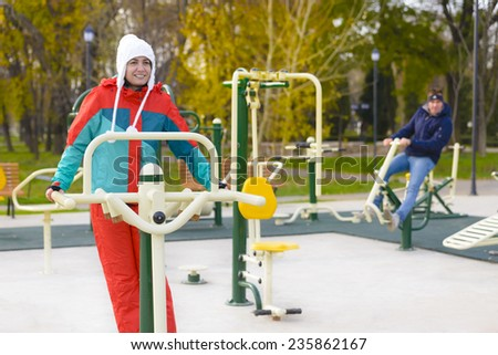 Young woman doing outdoor exercises in a park - stock photo