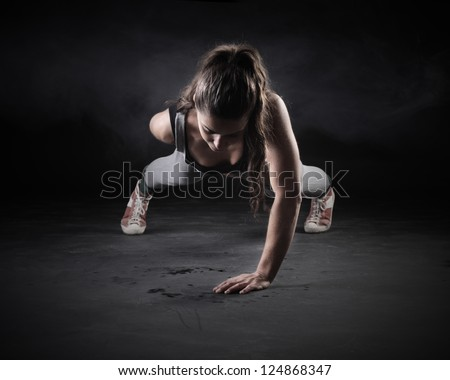 Young Woman Doing Push-Ups - stock photo