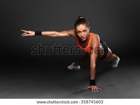Young Woman Doing Push-Ups  - stock photo